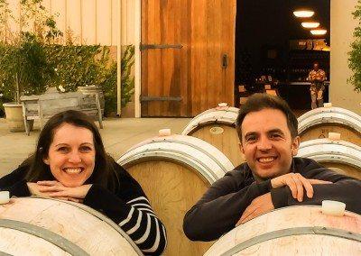 couple by wine barrels