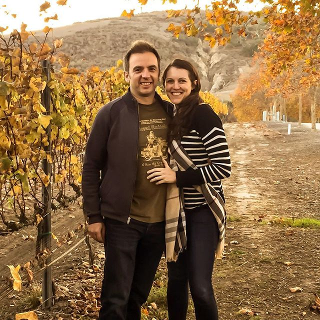 happy couple in winery